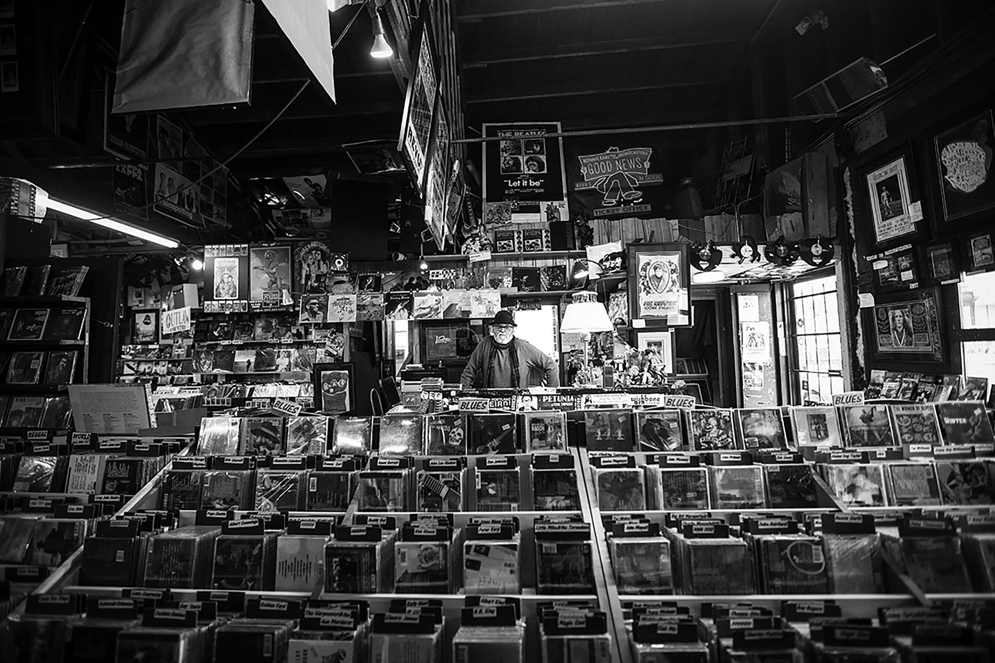 Jerry Keogh, owner of Heritage Posters & Music, is surrounded by the records and other paraphernalia that fill his shop on Monday, Feb. 29, 2016.
